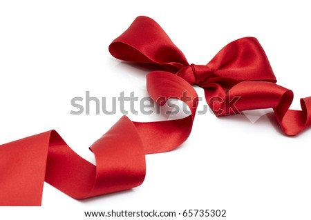 red silk ribbon on the white background - stock photo