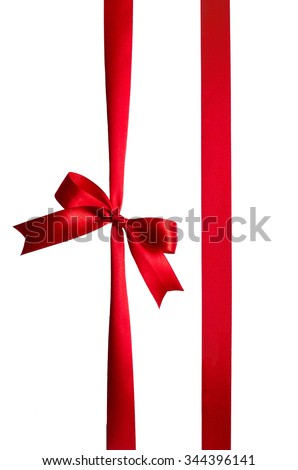 Red silk vertical ribbon bow on white background isolated