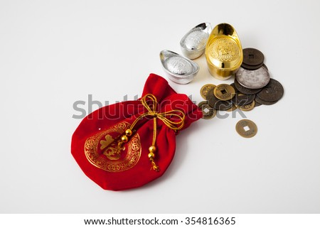 Red silky money bag with ancient Chinese coin : lucky pouch
