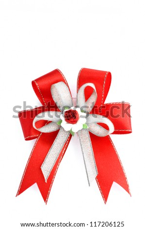 Red, silver gift ribbon bow isolated on white
