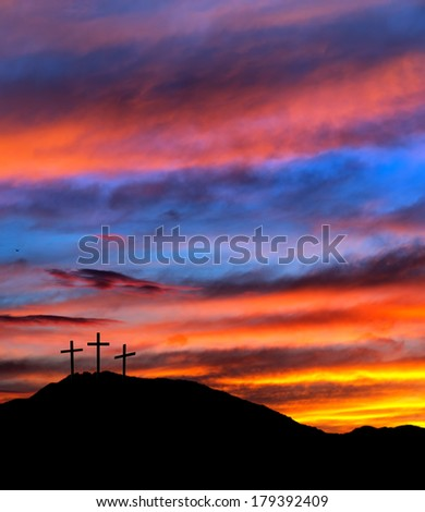 Red sky Easter scene with crosses - religious Christian background - stock photo