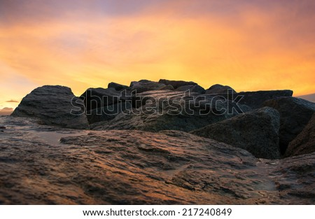 Red sky over a rocky