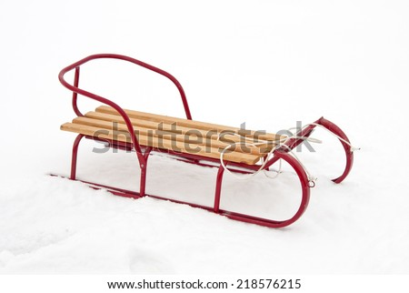 red sledge in the snow - stock photo