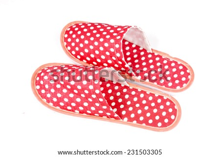Red slippers on a white background - stock photo