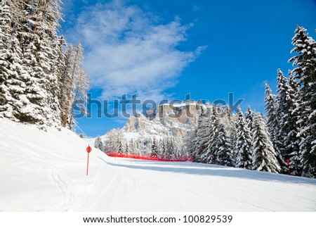 Red slope in Sella Ronda ski route, Dolomites, Italy - stock photo