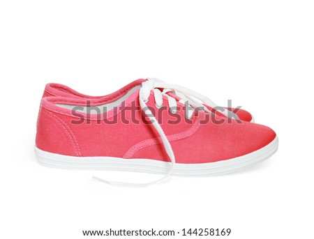 red sneakers isolated on white background - stock photo