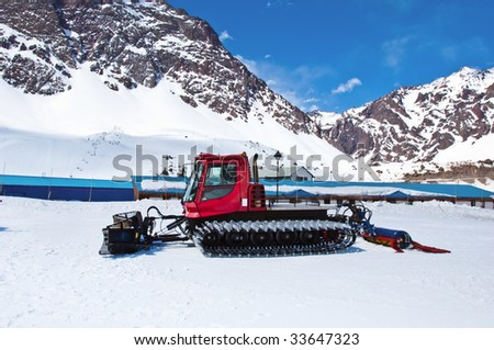Red snow-cat profile stay on snow. - stock photo