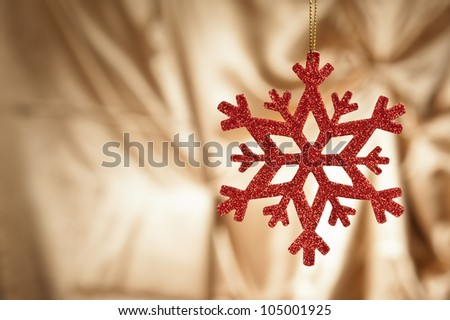 Red snow flake on a gold background for Christmas - stock photo