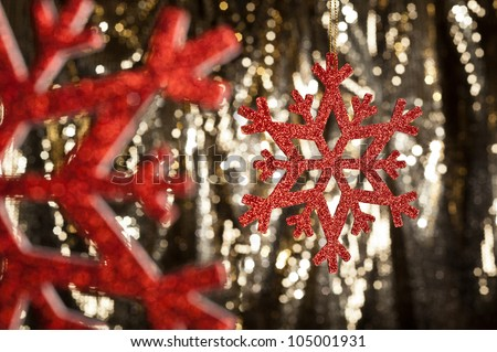 Red snow flake on a gold glitter background for Christmas - stock photo