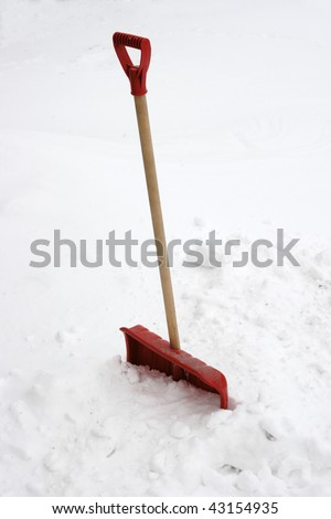 red snow showel burried in heavy snow - stock photo