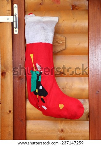 red socks hung to receive gifts from Befana - stock photo