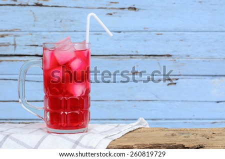 Red soda in glass put on wood background. - stock photo