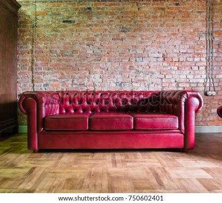 Beau Red Sofa Against A Brick Wall Loft