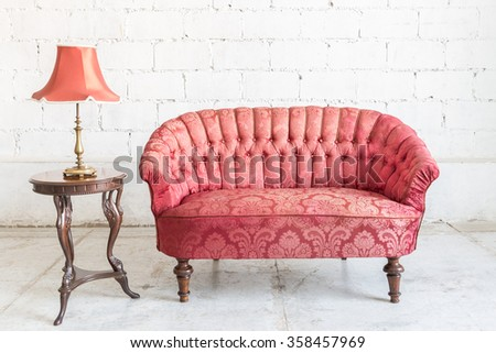 Red sofa couch in vintage room with lamp - classical style - stock photo