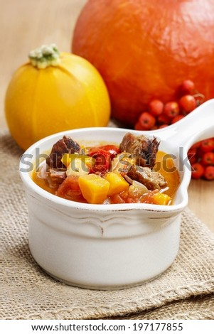 Red soup with vegetables and meat
