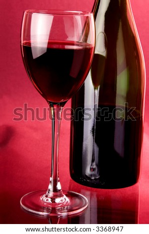red sparkling wine glass and green bottle