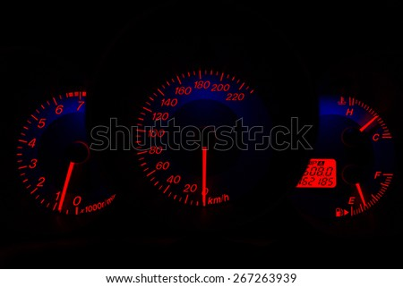 Red speedometer in car