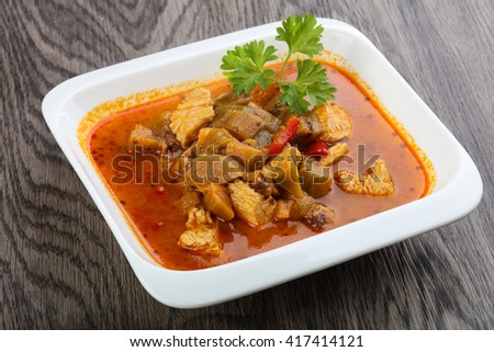 Red spicy curry with chicken meat - stock photo