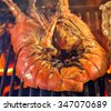 red spiny lobsters grill with flames closeup of delicious grilled seafood - stock photo