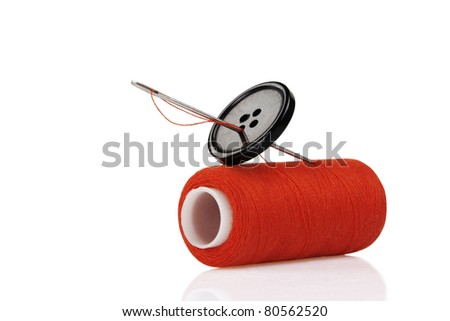 red spool, black button and needle isolated on white background - stock photo