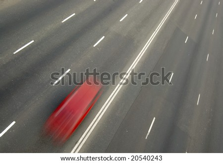 Red sport car driving on highway. With motion blur - stock photo