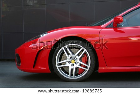 red sport car in the town wheel - stock photo
