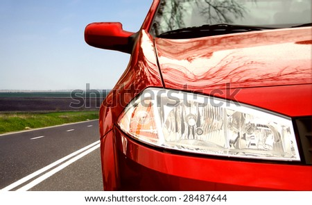 Red Sport car on a highway - stock photo