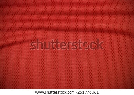 Red sport jersey shirt clothing texture and background - stock photo