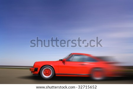 Red Sports Car in fast motion - stock photo