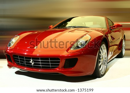 Red sports vehicle. Submitted as editorial. Part of a series of cars approved in my gallery. - stock photo