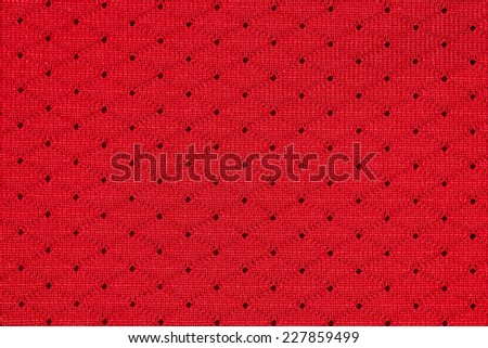 Red sportswear fabric with holes texture closeup photo background. - stock photo