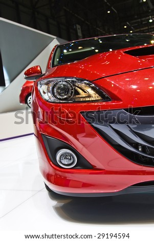 Red sporty car on display - stock photo
