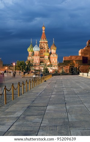 Red square at night, moving people around - stock photo