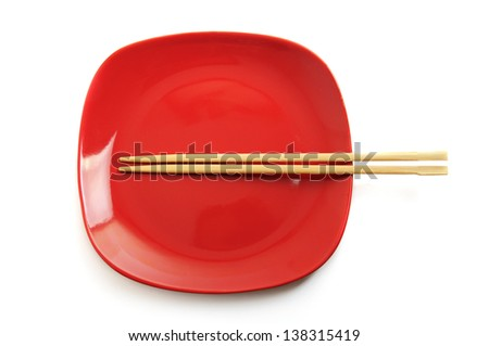 Red square empty dish with chinese sticks isolated on white - stock photo
