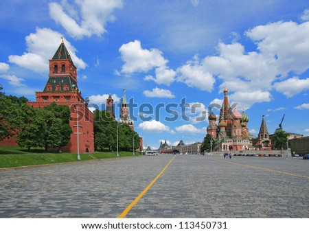Red Square, St. Basil's cathedral and Moscow Kremlin. The Kremlin was built in the 15 Century. - stock photo