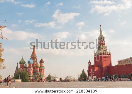 Red Square, the Cathedral and Spasskaya Tower on a background of clouds - stock photo