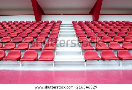 red stadium seat - plastic sit background show seating chair perspective - stock photo