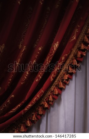 Red stage curtain drape tied   - stock photo