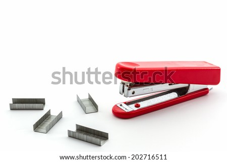 Red Stapler with staples wires on white background. - stock photo