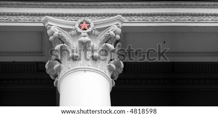 Red star on classic column - stock photo
