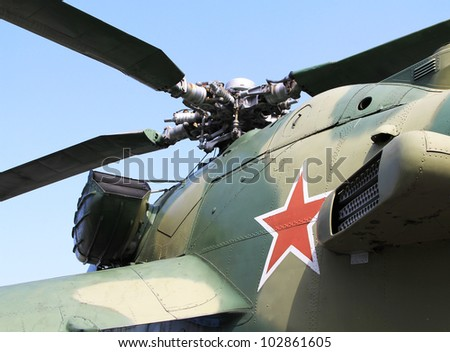 "Red star on Soviet/Russian Mi-26 ""Hind"" attack helicopter fuselage - stock photo"
