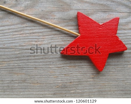 red star on wooden board - stock photo