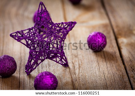 red star with golden ornament, small gifts and ribbons on weathered wooden board - stock photo