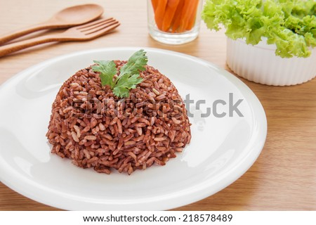 Red steamed rice on plate - stock photo