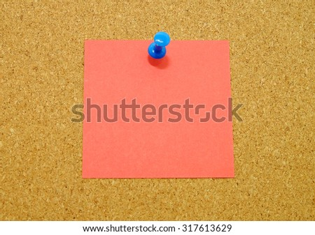 Red sticky note pinned on cork board background.