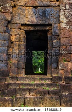 Red stone carving of door way at the kuupanna Sanctuary Temple in Sakon Nakhon, Thailand - stock photo