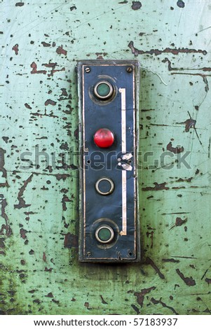 Red stop button on an old machine - stock photo