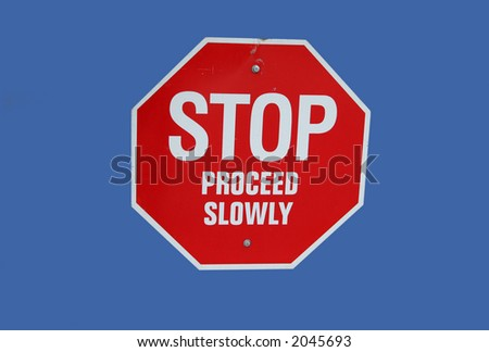 red stop proceed slowly sign