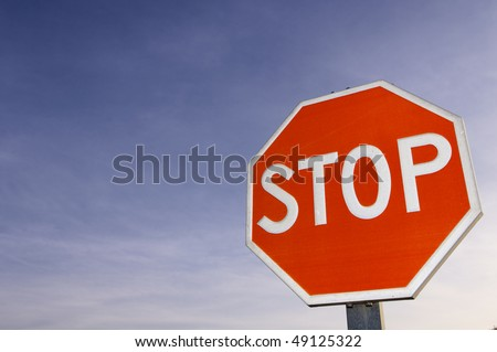 red stop signal with cloudy sky - stock photo