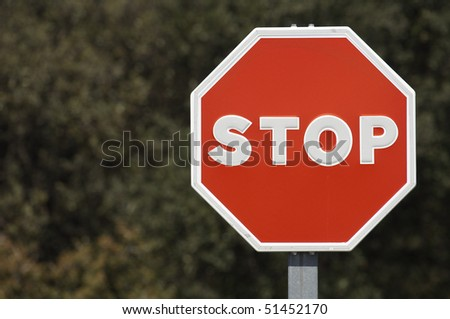 red stop signal with dark background - stock photo